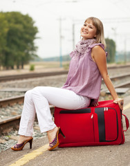 woman with luggage waiting  train
