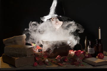 halloween witch with cauldron