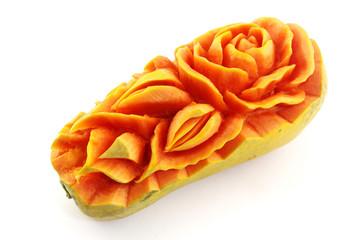 carved papaya on white background