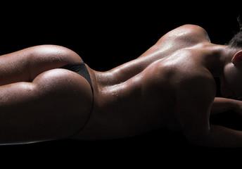 Sexy woman body, wet skin, black background - fototapety na wymiar