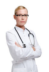Serious lady doctor with stethoscope, isolated on white