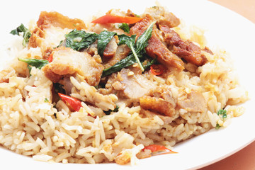 rice topped with stir fried crispy pork and holybasil