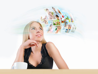 Young woman has images around her head representing entertainmen