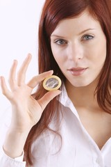 young woman with a condom (focus on condom)