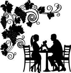 Background with grapes and romantic couple in restaurant