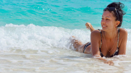 Attractive woman lying in shallow water