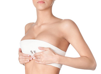 Preparing to breast correction, isolated, white background