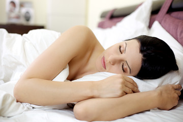 woman sleeping in the morning in beautiful pink bed