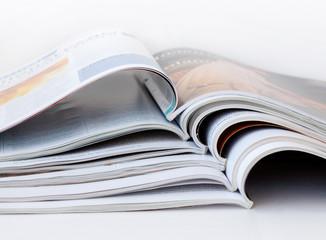 Pile of open magazines