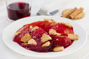 baked fruits with cookies on the white plate