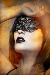 mysterious naked woman with Venetian mask intense gesture