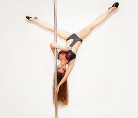 Girl making figure of poledance sport
