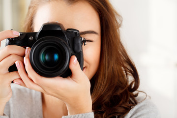Pretty woman is a proffessional photographer with dslr camera