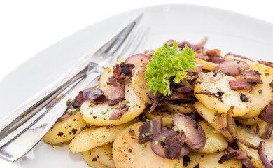 Plate with fried Potatoes on white