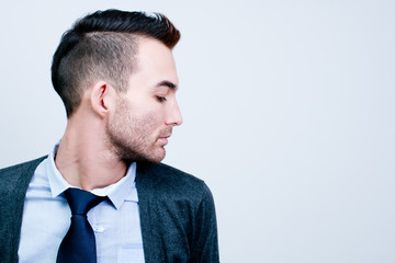 closeup portrait of handsome young adult man - side view profile