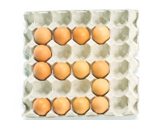 Number five made of  eggs  on white background.