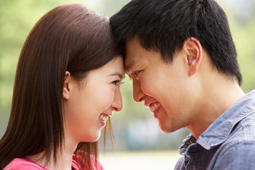 Portrait Of Young Chinese Couple Looking At Each Other
