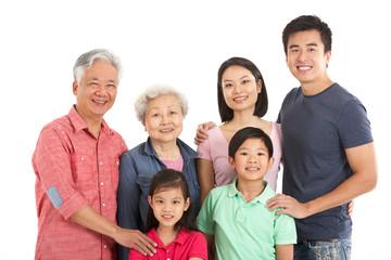 Studio Shot Of Multi-Generation Chinese Family