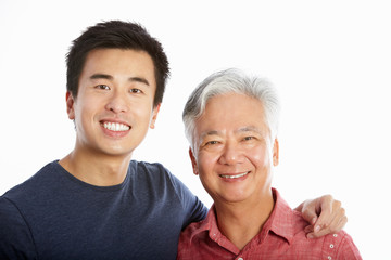 Studio Portrait Of Chinese Father With Adult Son