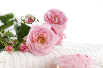 health spa –branch rose on towel with salt in bowl