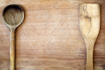 Old grunge wooden cutting kitchen desk board with spoon