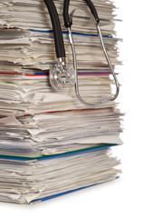 Stack of papers with stethoscope