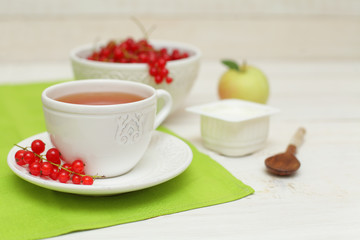 Tea and redcurrant, food background