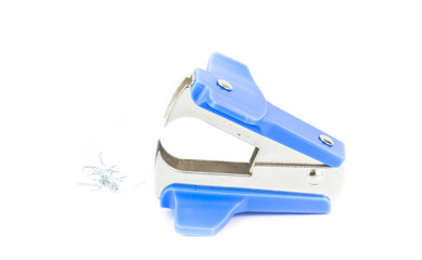 staple remover with used staples lying on the white background