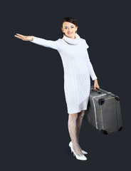 Beautiful girl in white, with a large suitcase.