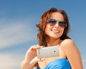 happy smiling woman using phone camera