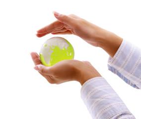 Green planet in women's hands