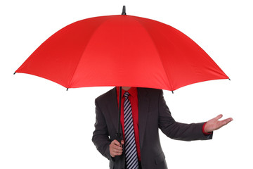 Businessman holding red umbrella