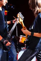 Men playing  guitar.