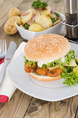 Fish Burger with fried Potatoes in a bowl
