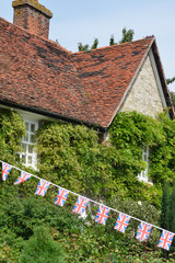 English Cottage with union flag Bunting