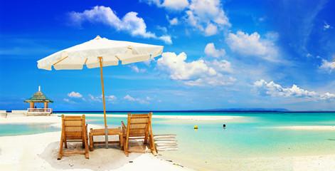 Wall Mural - beautiful  tropical  sandy beach with umbrella and beach chair