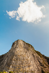 Carved buddha image on the cliff at Khao