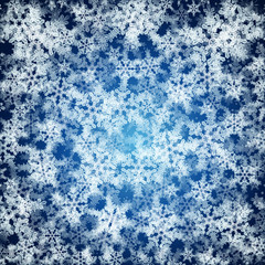 Christmas background made ​​of realistic falling snowflakes.