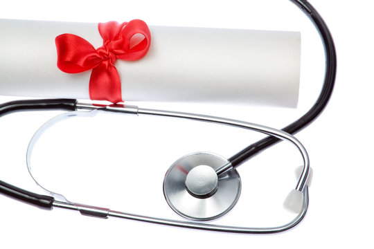 Stethoscope on background of Certificate. Closeup.