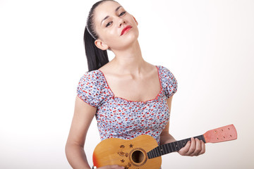 Young beautiful girl with guitar smiling