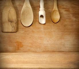 Old grunge vintage wooden cutting kitchen desk board with spoon