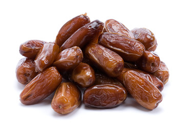 Dried dates over white background