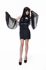 Beautiful young lady wearing black dress with wing