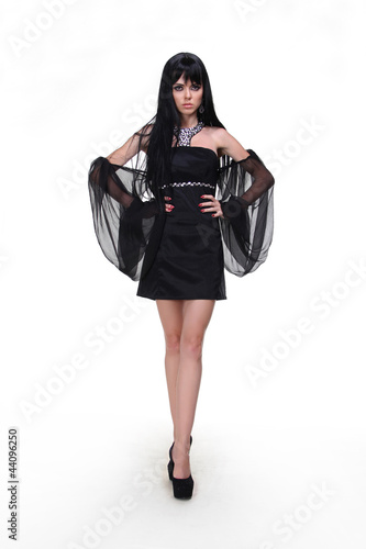 92317f6ee2 Fashion woman model wearing black dress with wing