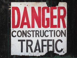 Old sign with text danger construction traffic
