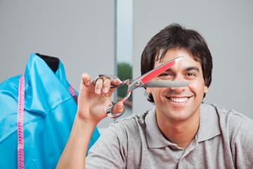 Happy Dressmaker Holding Scissor