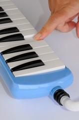 Pianica blow-organ.