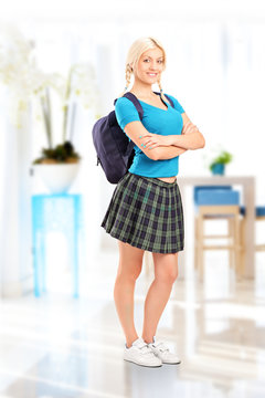 Full length portrait of a female student standing