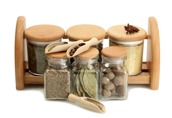 Poster Kruiden 2 jars and wooden spoons on shelf with spices isolated on white
