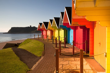 Beach huts at sunrise in Great Britain